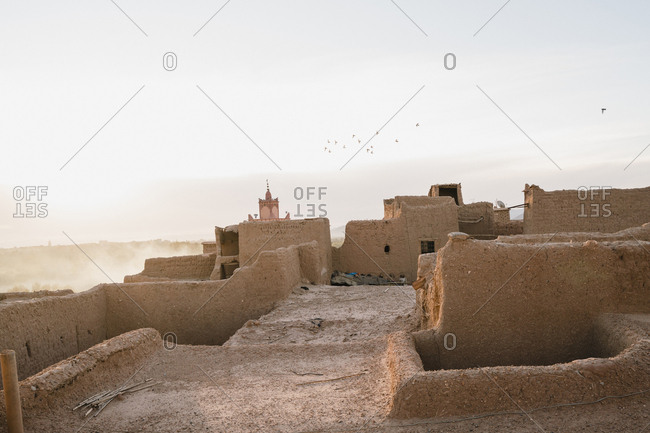 Houses in village against sky