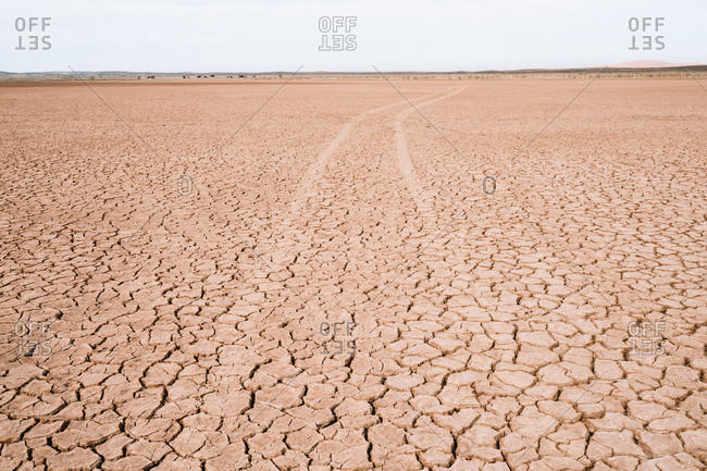 Scenic view of barren landscape against sky during sunny day