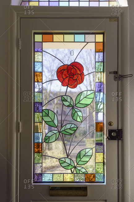 The Netherlands - February 7, 2018: A rose in leaded glass in the front door of a house