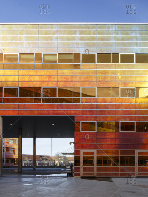 Almere, The Netherlands - January 30, 2018: Exterior of La Defense contemporary office building with colorful reflective wall