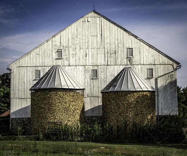 Winter feed in silos beside barn