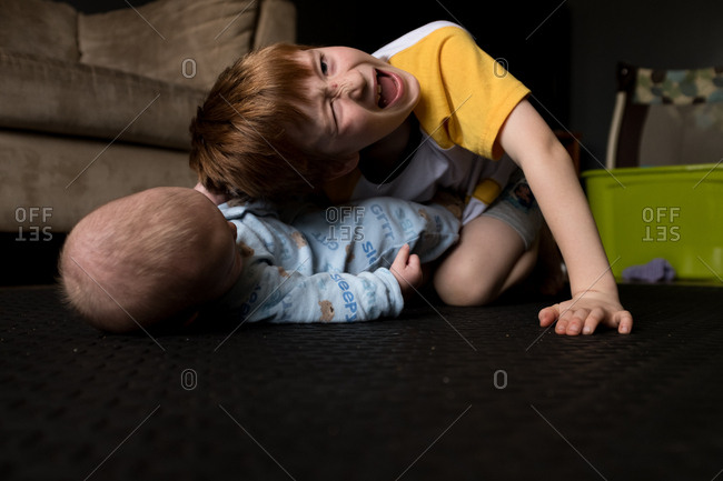 Baby pulling brother's hair