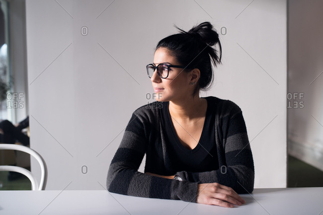Profile view of young creative woman in meeting room