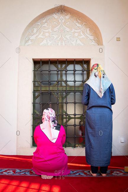 Muslim women praying during Ramadan at mosque