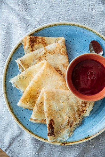 Crepes with a side of fruit sauce