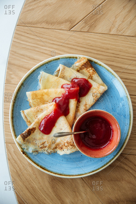 Fruit crepes served on a wooden table