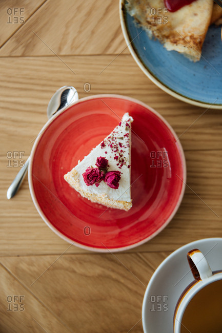 Overhead view of a slice of pie with dried roses
