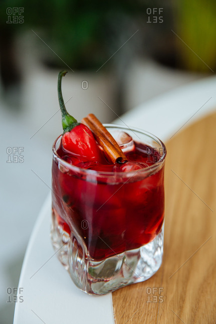 Fruity cocktail with pepper and cinnamon garnish