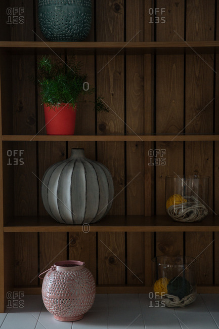Decorative jars and containers on a wooden shelf