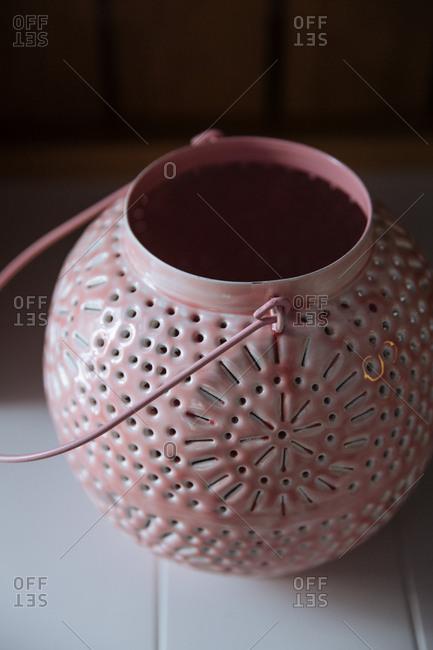 Close up of a pink metal lantern