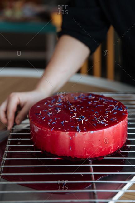 Red mirror glazed cake with sprinkles