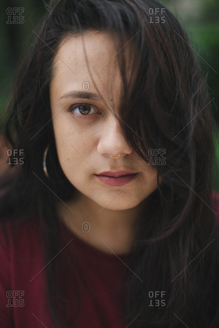 Portrait of dark haired woman with nose ring