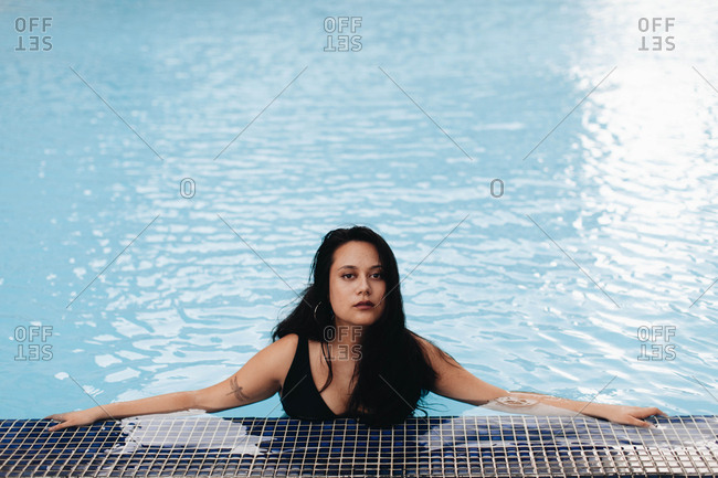 Beautiful dark haired woman in a pool