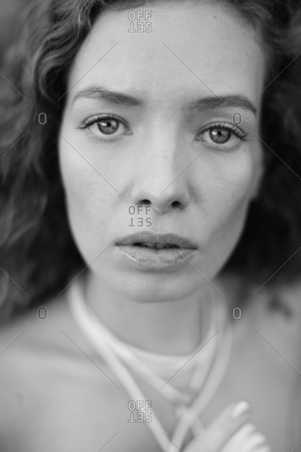 Black and white portrait of beautiful European woman with curly hair
