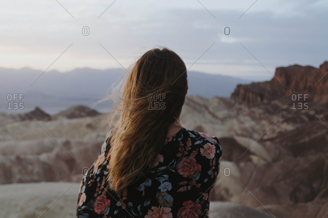 Young woman looking out over Zabriskie Point in Death Valley National Park
