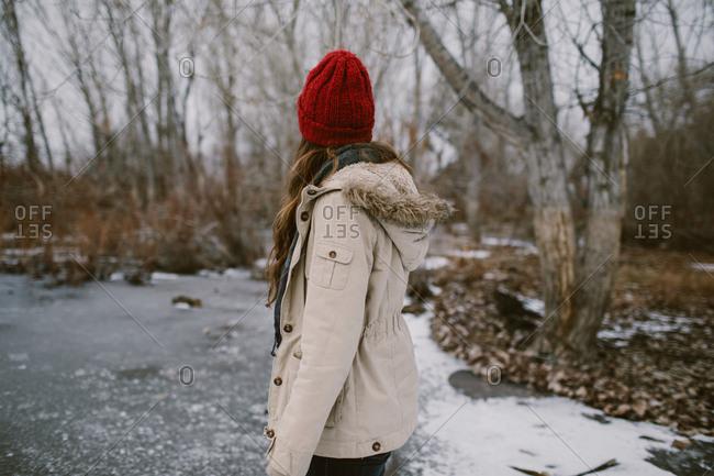 Woman on a frozen lake outdoors