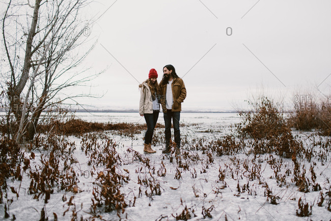 Man and woman on a frozen lake outdoors