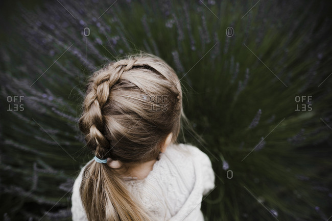 High angle view of girl with hairstyle playing amidst lavender field