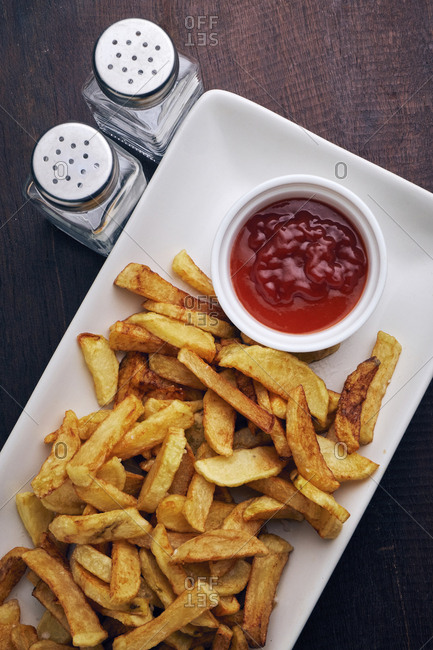 High angle view of french fries and tomato sauce served in plate on table