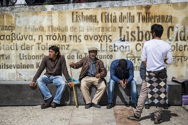 March 28, 2016: Men relaxing in the center of Lisbon, Portugal.