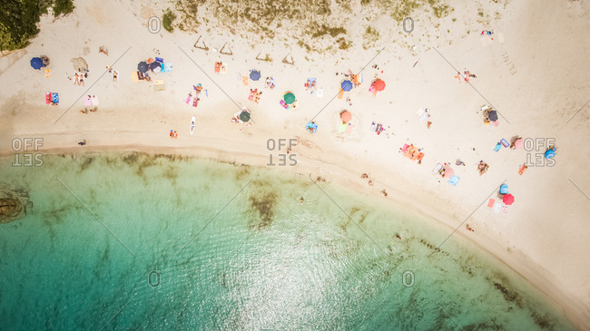Aerial view of people on the beach of Punta Molentis, Sardinia, Italy.