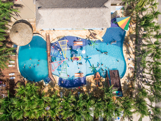 FORTELEZA, BRAZIL - 29 July 2016 : Aerial view of people swimming in swimming pool close to the beach in Brazil.