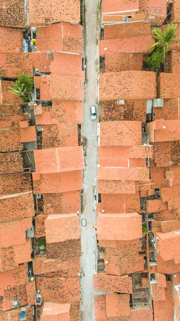 Aerial view of a red rooftops and street in a neighborhood in Brazil.