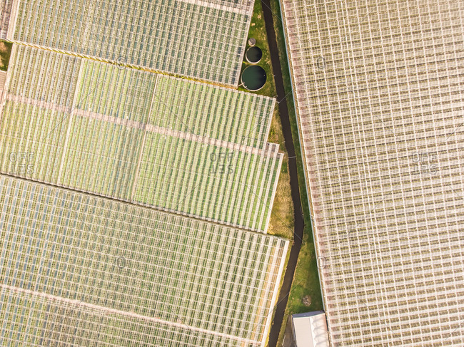 Abstract Aerial view of glasshouses in farm.