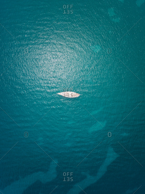 Aerial view of a sailing boat moored in the mediterranean sea.