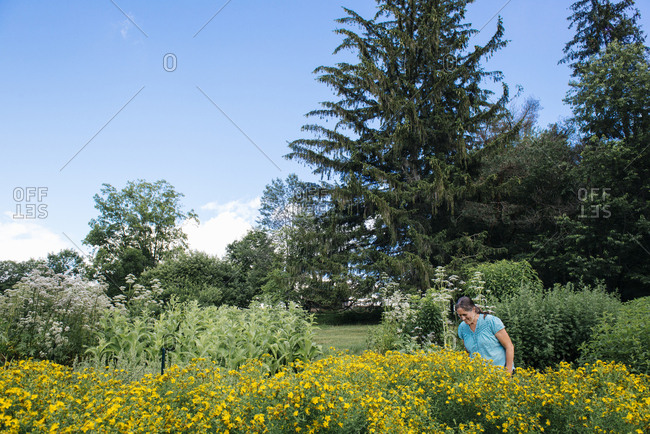 Mature woman standing in garden