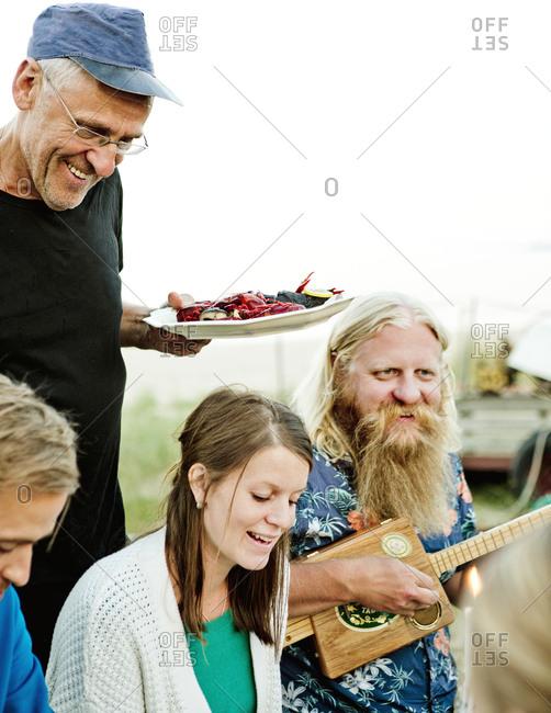 Family eating together in Friseboda, Sweden