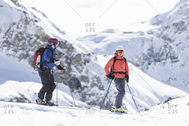 Two skiers on mountain in Piedmont, Italy