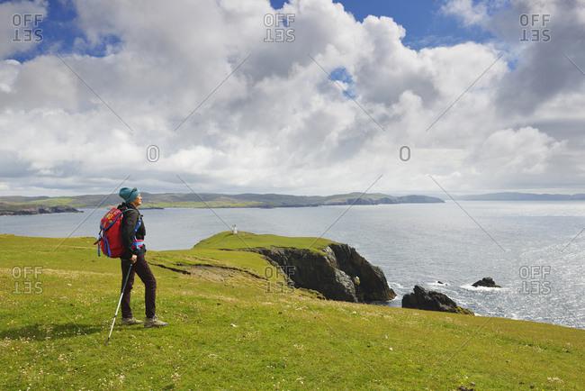 Woman hiking in Hillswick, Scotland