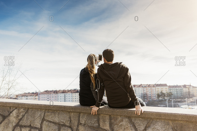 Rear view of couple taking selfie in Stockholm, Sweden