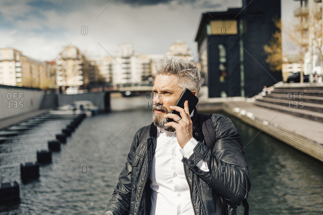 Man on smart phone in Stockholm, Sweden