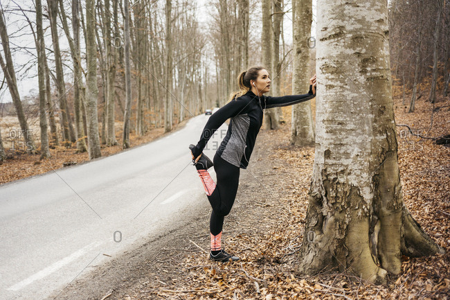 Young woman stretching in Sodermanland, Sweden