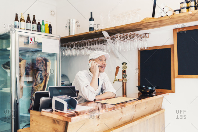 Butcher on phone in Sweden