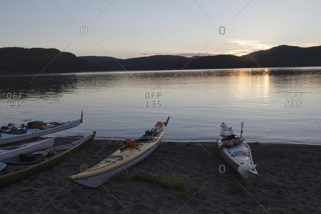 Kayaks beside river in High Coast, Sweden