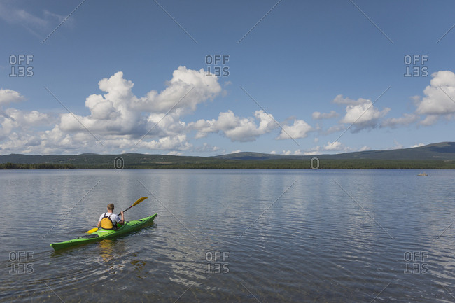 Kayaker on lake in Jatmland, Sweden