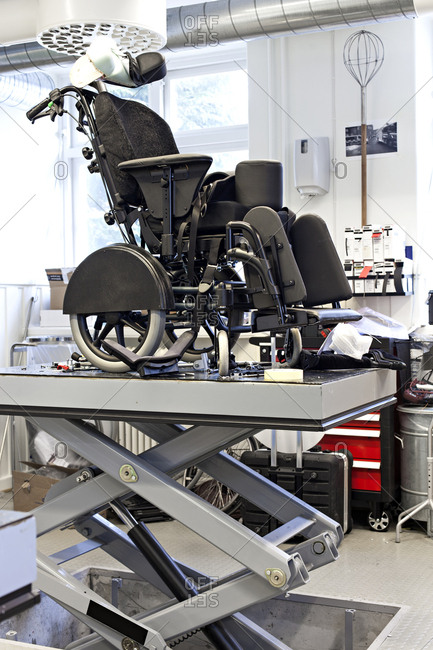 Powered wheelchair in workshop