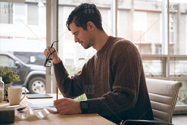 Male executive working at desk in office