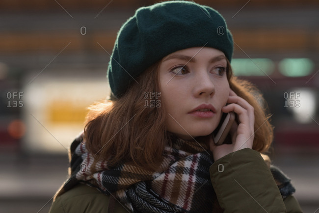 Close-up of woman in winter clothing talking on mobile phone
