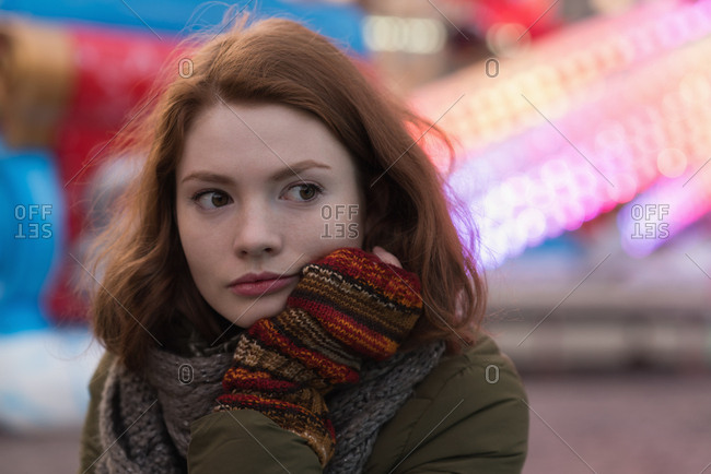 Thoughtful woman in winter clothing