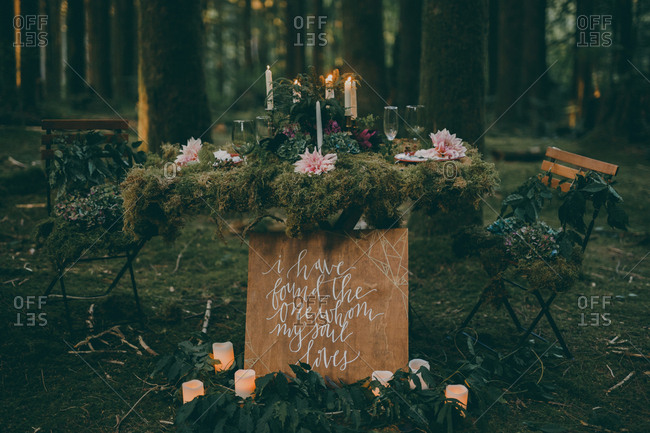 Nature inspired wedding table in the forest ready for bride and groom