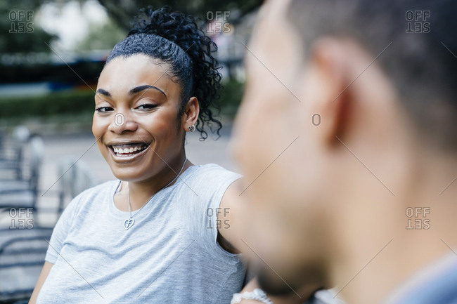 Black woman laughing with man