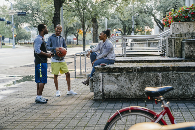 Black friends with basketball hanging out