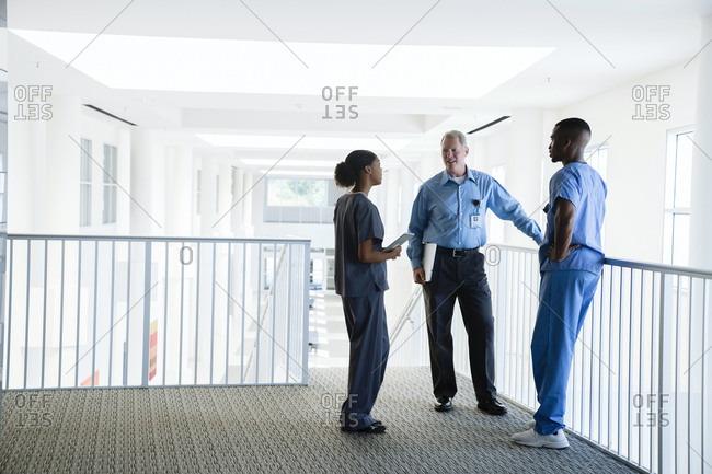 Doctor and nurses talking near staircase