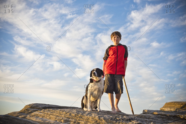 Caucasian boy hiking with dog