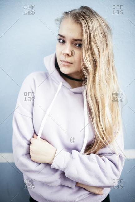 Portrait of serious Caucasian woman wearing hoodie