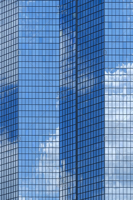 Reflection of blue sky and clouds in modern building windows